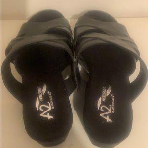 A2 heelrest black wedge sandals